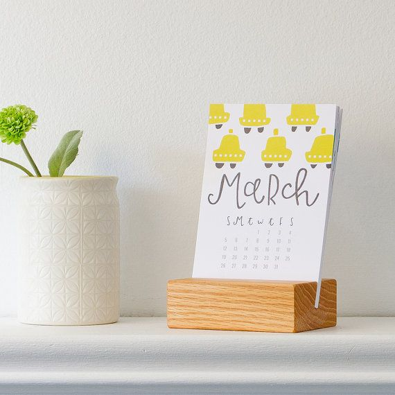 Spruce up your desk next year with our 2017 desk calendar! This calendar has custom lettering and illustrations by Pinwheel Print Shop, with a unique design for every month. Makes for a great stocking stuffer or gift for the office.  This calendar comes with a handcrafted red oak stand, created by Cincinnati-based shop Happy Bungalow (etsy.com/shop/HappyBungalow).  12-MONTH CALENDAR WITH WOOD STAND  ----- the calendar -------  paper: digital print on 100# Accent Cover paper size: 4.25 x 6.25…