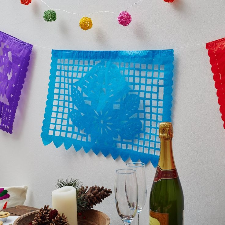Multicolour Mexican Fiesta  The strip comes in different colours (one flag each of: blue, yellow, green, red, purple, pink) and comes in a pinata and Christmas bells design. The bright colours will brighten up any room!