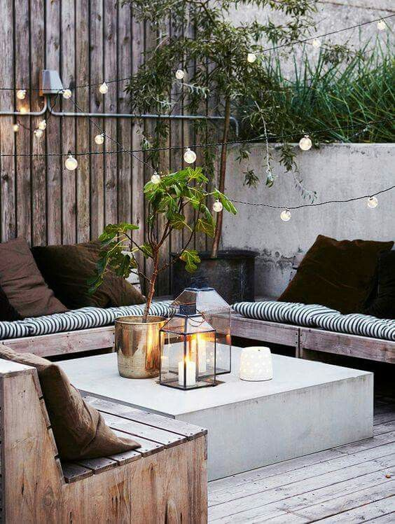 Outdoor cosy on our concrete area, add plants and lights