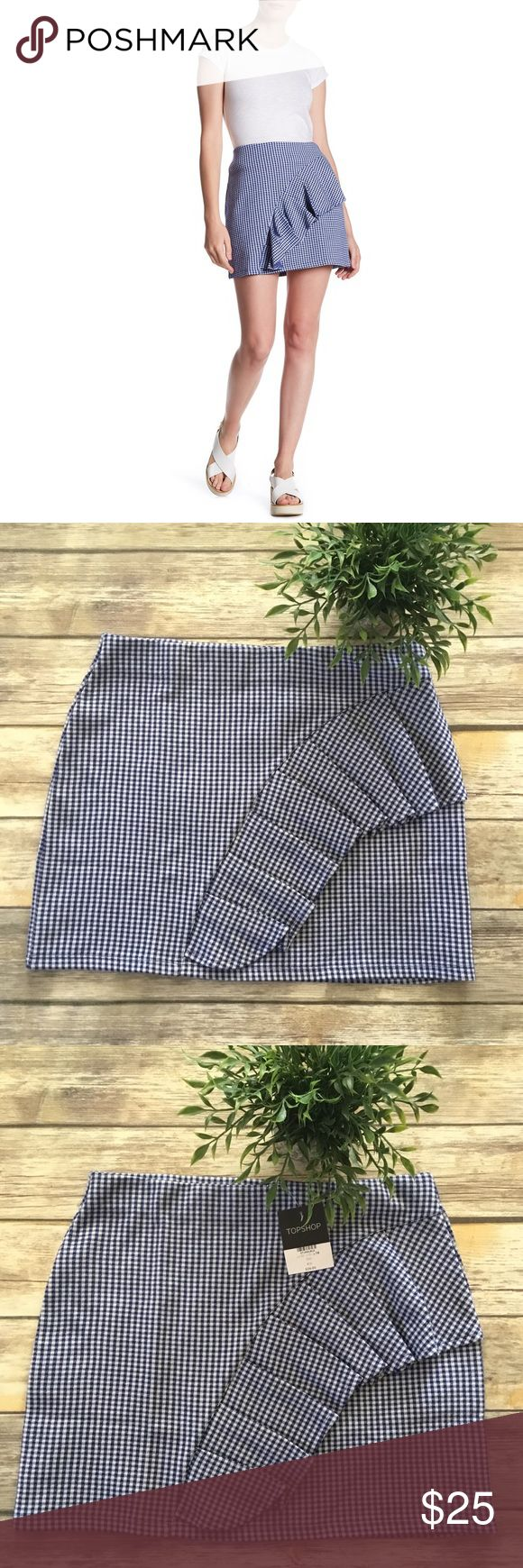 Topshop Gingham Ruffle Jersey Mini Skirt This size 10 Topshop Gingham Ruffle Jersey mini skirt is NWT. The ruffle detail travels from the side seam for a girlie touch. It's 51% Polyester, 49% Cotton and can be machine washed. Topshop Skirts Mini