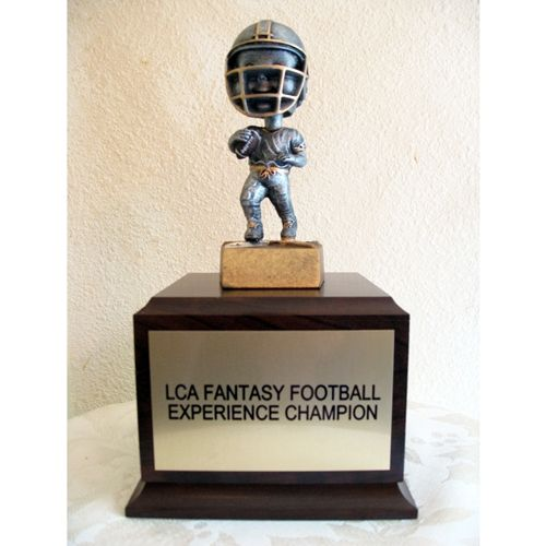 """Fantasy Football perpetual Trophies SKU:PT100 TrophyPartner.com This 10"""" trophy is perfect for Fantasy Football as shown or other sports. We mount a bobblehead on a large wood base."""