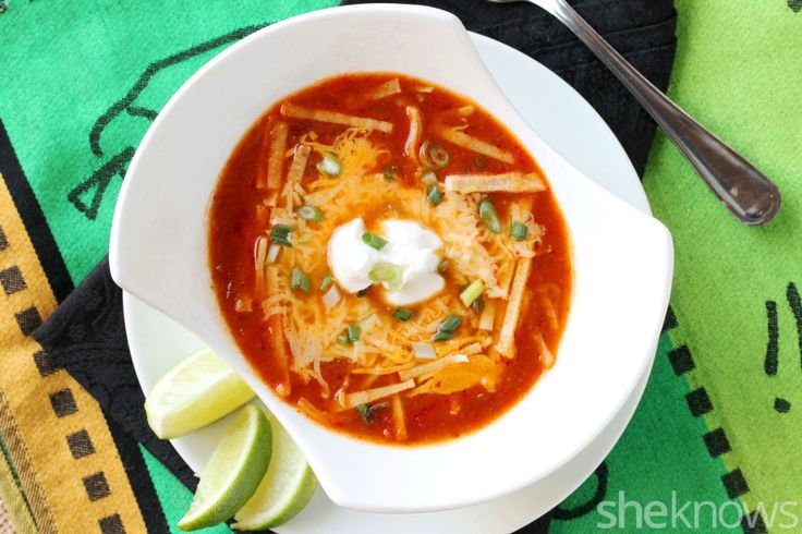 Slow cooker cheesy, spicy enchilada soup is the easiest dinner you'll make all week