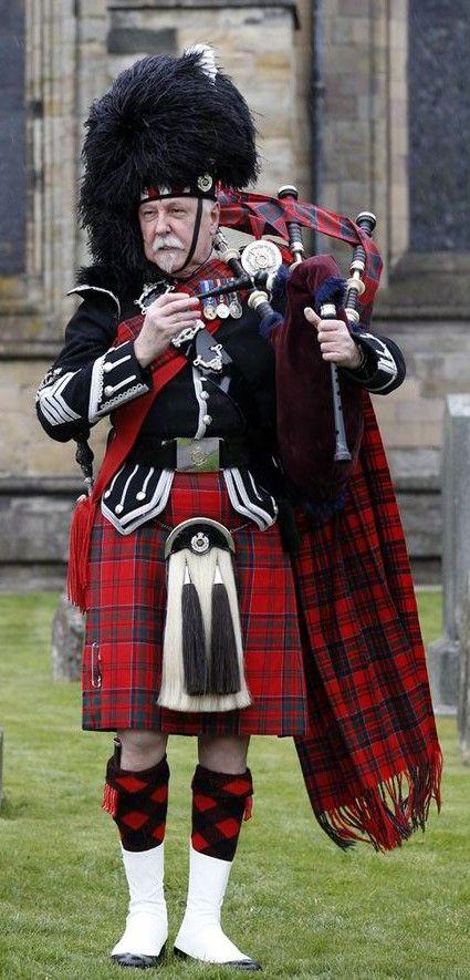 Bagpiper in full Highland dress