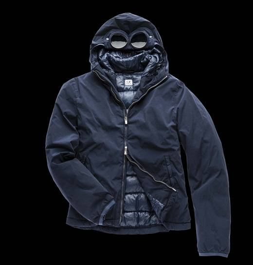 Technically engineered Goggle Bomber in double dyed stretch nylon with water resistant treatment. Feather padded, this engineered article interprets the CP Company urban style.