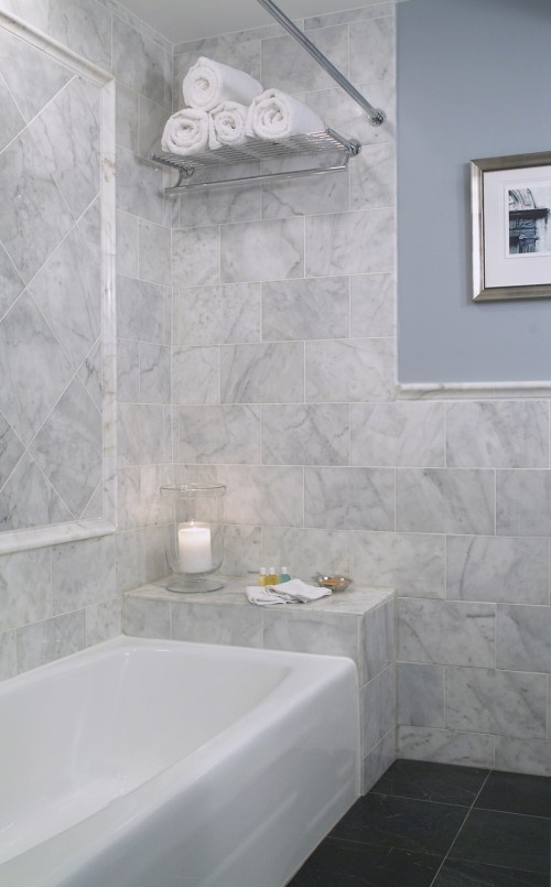 Bullnose subway tile to the edge of the shower chair rail for Chair rail ideas for bathroom