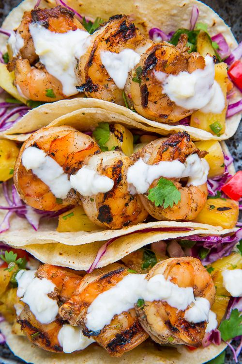Jerk Shrimp Tacos with Pineapple Salsa, Slaw & Pina Colada Crema. The combo of spicy jerk shrimp, sweet and juicy #pineapple salsa, crunchy cabbage and creamy pina colada crema in these #tacos is simply divine!