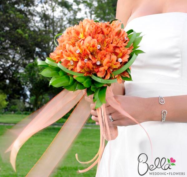 Orange Peruvian Lilies Bridal Bouquet.  I wonder if any florists carry these in Nashville?! Al is from Peru, these would be PERFECT!