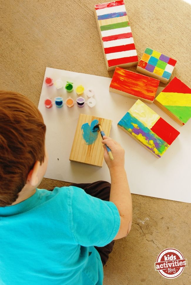 Make Colorful Wooden Blocks for a gift - great creative gift for a little builder (you can gift them the wood and the paint so they can make their own!)  via Kids Activities Blog