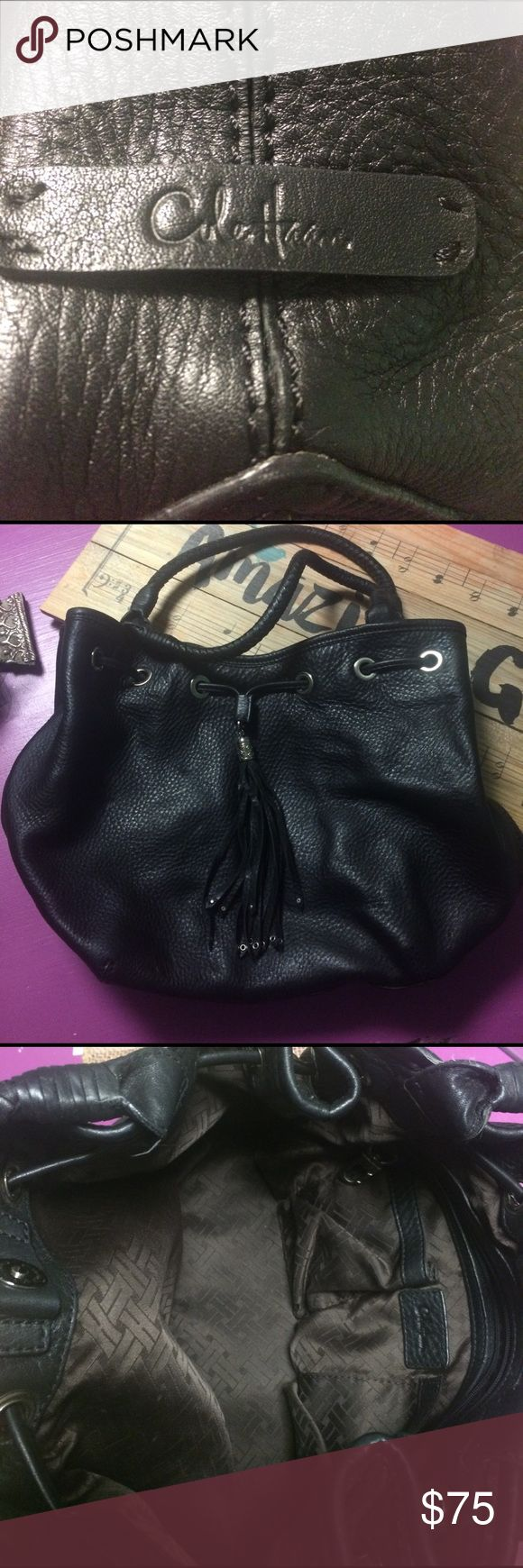 Cole Haan Purse Authentic Cole Haan black leather purse with drawstring/tassels, 2 handles, magnetic closure, and multiple pockets inside. Like new. No scratches, still smells new, no stains on inside. Cole Haan Bags
