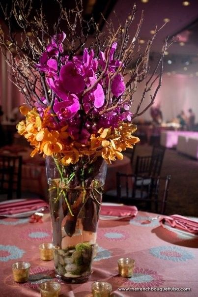 Tall centerpieces of purple phaelenopsis orchids orange for Tall wedding centerpieces with branches