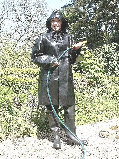 Well dressed for gardening in her SBR mac, waders and sou'wester