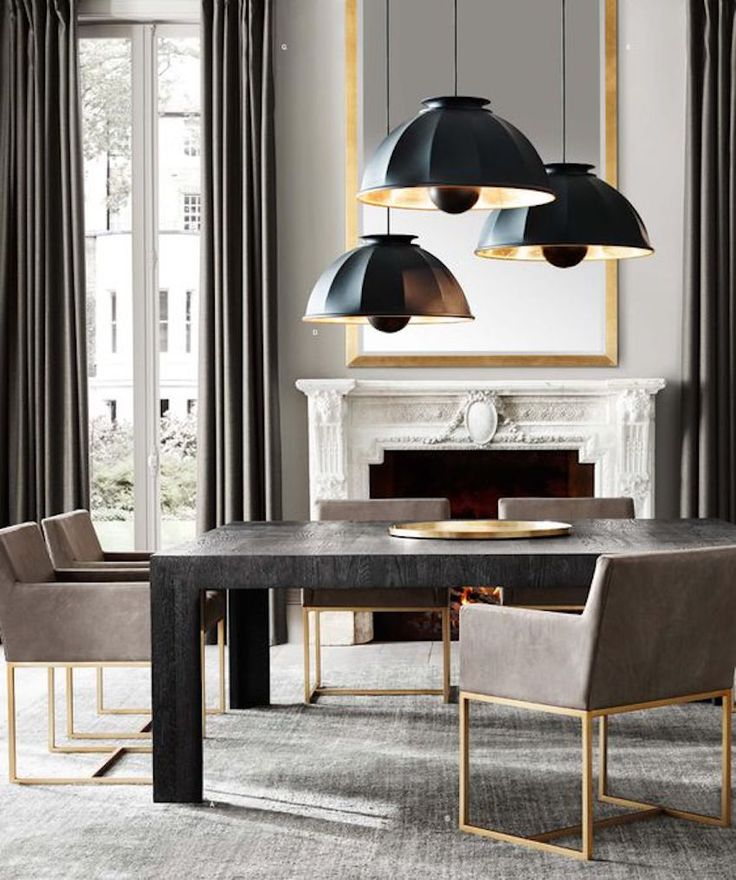 Beautiful modern dining room with a gorgeous marble fireplace and stunning modern black dining table. Brass base chairs with contemporary lighting finish this set. ➤ Discover the season's newest designs and inspirations. Visit us at  www.moderndiningtables.net #diningtables #homedecorideas #diningroomideas @ModDiningTables