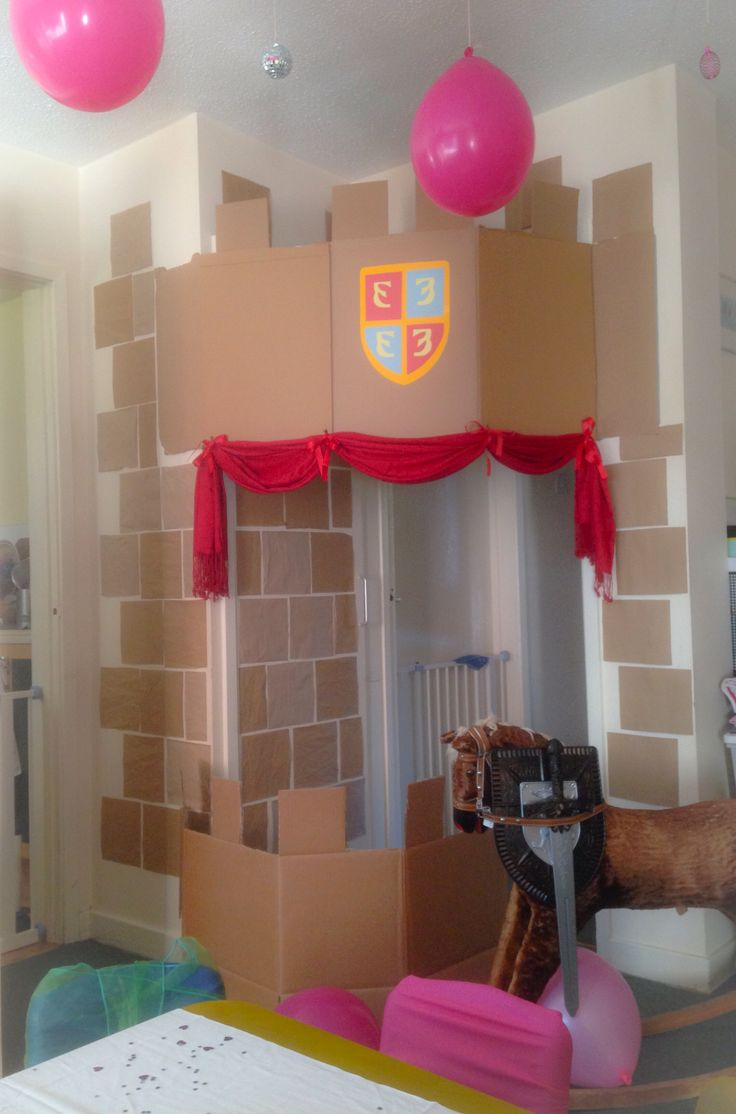 Cardboard Castle: DIY Princess & Knight party idea... Great for small houses! Tiles were cut from free brown paper packaging saved from Amazon deliveries.. A large cardboard box provided the base for the balcony, and was finished with a homemade shield and old pashmina for the royal red touch!