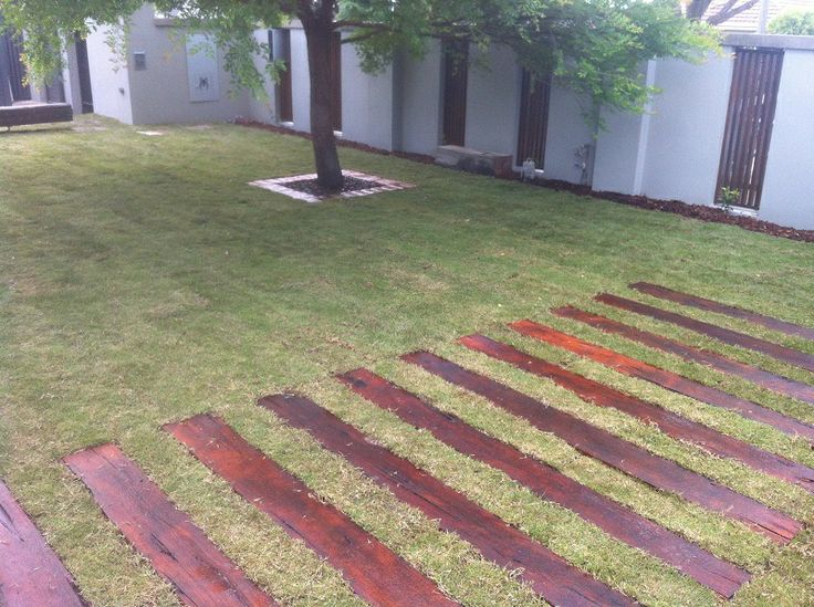Redgum sleepers in the lawn creates an ideal place to wash your car, for the environmentally conscience.