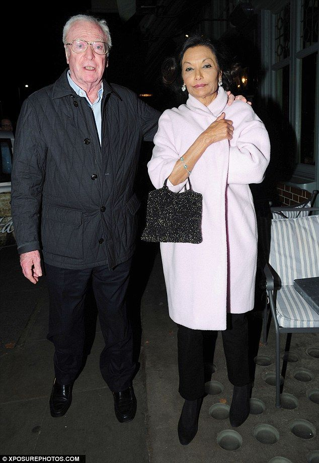 Michael looked just as smitten with his beautiful spouse as put a protective arm around her shoulder on their way out of the restaurant