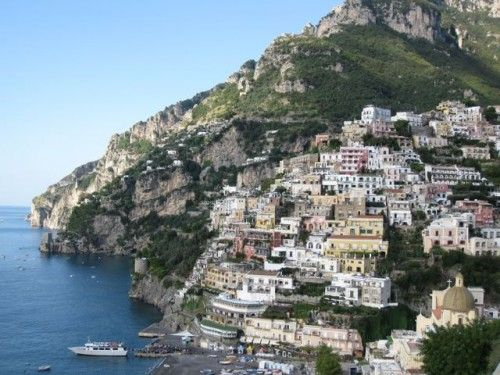 POSITANO -   Positano is a village and comune on the Amalfi Coast (Costiera Amalfitana), in Campania, Italy. The main part of the city sits in an enclave in the hills leading down to the coast.