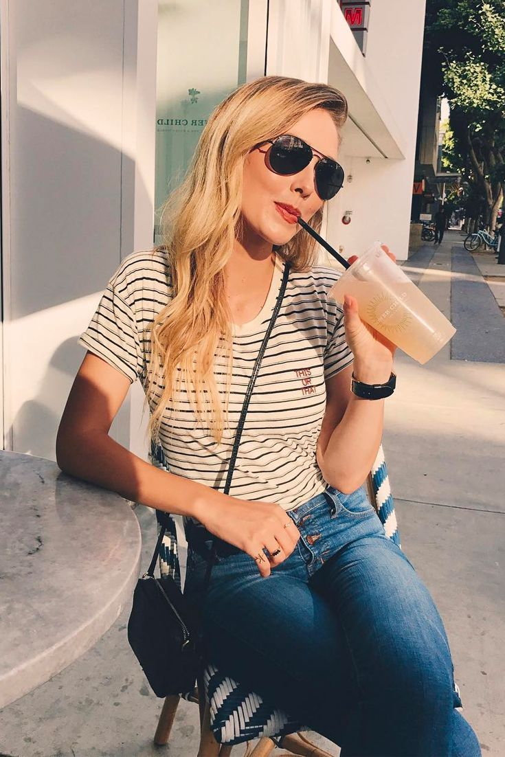 Casual outfit, dark blue jeans, striped shirt and black leather shoulder bag. Sunglasses, long hair with waves, fashion blogger, fashion outfit, fashion style, easy to copy, inspiration, summer outfit. Sheridan Gregory, blue eyed finch.