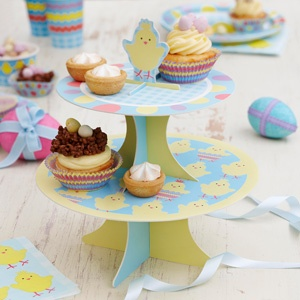 This two tier cute chick cake stand is perfect as a Easter table centre piece.  Display with Easter sweet treats, such as cupcakes and crispy chocolate birds nests with mini eggs on.  Alternatively, why not serve an Easter afternoon tea for your friends and family.  Present cakes, scones and sandwiches on this gorgeous reversible cake stand.  Order online at the Fuschia boutique for £7.99 at www.fuschiadesigns.co.uk.