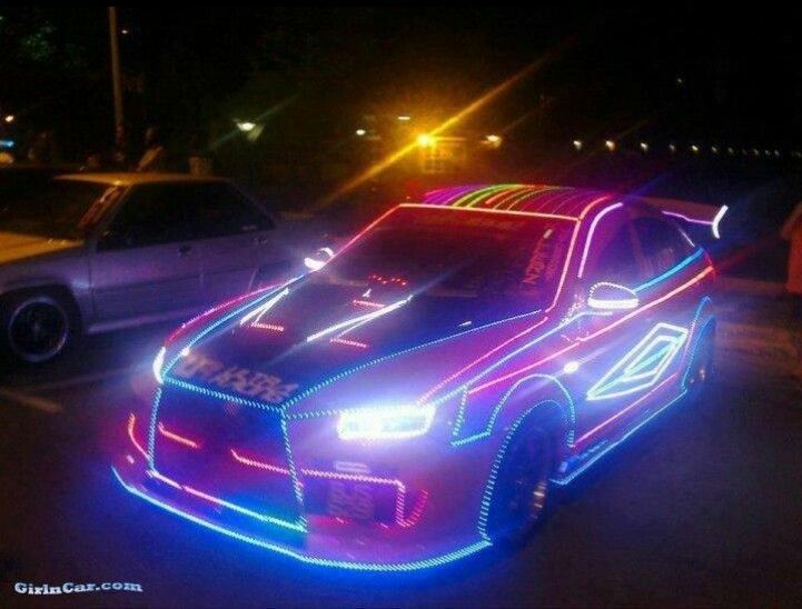 Sports car decked out in LED lights. Neon hot rod, baybeh, that is dang cool!
