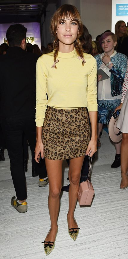 Alexa Chung perfected in-between weather dressing at the Topshop Unique spring/summer 2015 show in a long-sleeve yellow knit and a leopard print mini skirt. A blush pink chain purse and metallic gold pointy-toe flats were the finishing touches. #InStyle