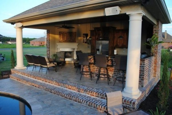 backyard paradise inground gunite saltwater pool with southern style outdoor kitchen and fireplace a true resort style oasis pools design pinterest