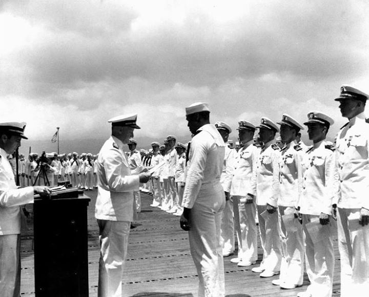 On this day in history: Doris Miller receiving the Navy Cross award from Admiral Chester Nimitz onboard carrier Enterprise Pearl Harbor US Territory of Hawaii 27 May 1942.