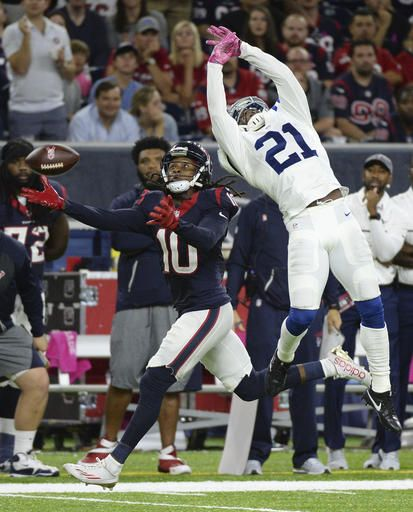 Indianapolis Colts cornerback Vontae Davis (21)  defends on a pass intended for Houston Texans  wide receiver DeAndre Hopkins (10) during the  second half of an NFL football game Sunday,  October, 16, 2016, in Houston. (AP  Photo/George Bridges)