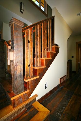 Reclaimed lumber floor stair and railing finished with Waterlox