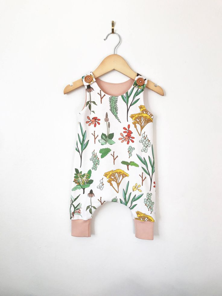 Baby girl romper in floral print // toddler romper // baby romper // button romper // baby clothes // organic baby clothes by LolaandStella on Etsy https://www.etsy.com/uk/listing/562403563/baby-girl-romper-in-floral-print-toddler