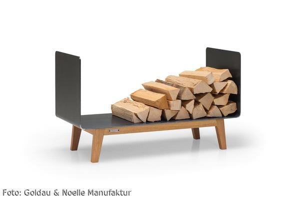 Das Kaminholzregal FERRA kombiniert den industriellen Charme von rohem Stahl mit der Natürlichkeit edel verarbeiteten Massivholzes. Durch das kompakte Design findet es selbst in der kleinsten Wohnung Platz und verwandelt Ihr Brennholz zu einem wahren Blickfang.     Wanne aus 5 mm Zunderstahl.  Gestell wahlweise aus Eiche oder Nussbaum massiv.  Erhältlich in zwei Größen: 60 oder 90 cm breit.