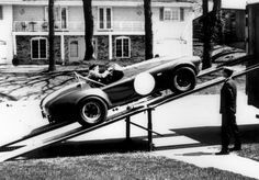 Unloading CSX 2557 in front of Dick Roe's home, Dick is standing to the right. At this point, CSX 2557 was probably the least-used team car in Shelby's basket of cars, having only been raced at Bridgehampton 1964 by Charlie Hayes.