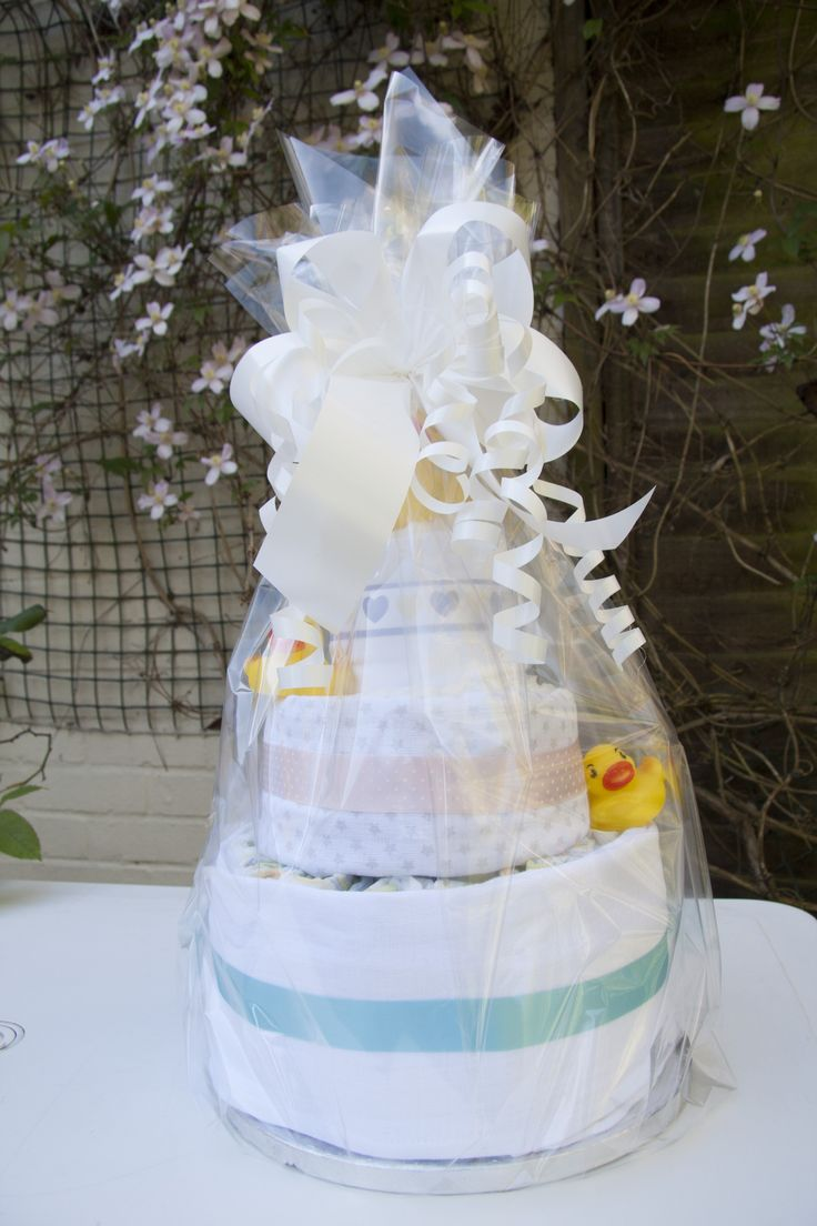 i made this for my friends baby shower, includes muslin cloths, nappies and baby grow all put together to make a beautiful nappy cake.