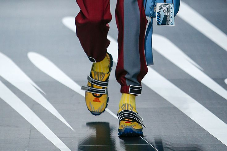 Prada men shoes spring 2018 is about the dialogue of two opposite worlds, featuring oxfords with molded rubber soles as seen on fashion sneakers, studded caged sandals and Velcro strapped slip on sneakers.Prada men spring 2018 collection was inspired by comic books.   #men shoes #Prada #shoes 2018