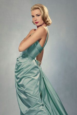 The Timeless Grace Kelly: Wearing a gown by Edith Head in 1955. Photo by Philippe Halsman