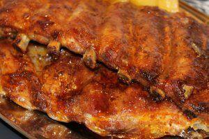 Reteta culinara Coaste de porc in vin la cuptor din categoria Porc. Cum sa faci Coaste de porc in vin la cuptor