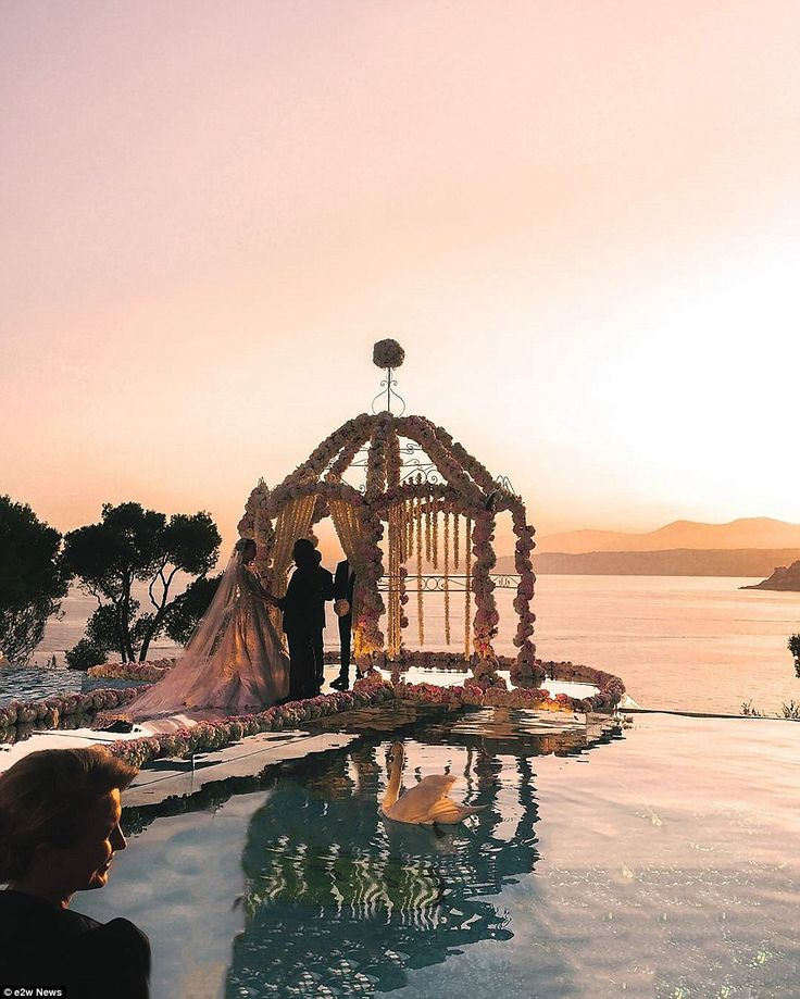 The gorgeous sunset over the French Riviera as the couple wed outside the villa used for ...