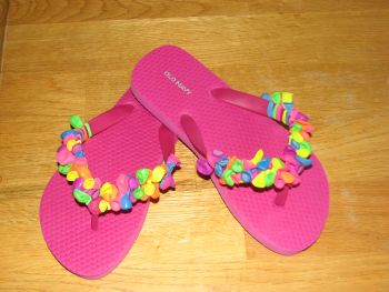 flip flop craft - I tried to do it with the girls - not fun for them, you have to pull tight, and their fingers got tired. However, they were (are) very cute!