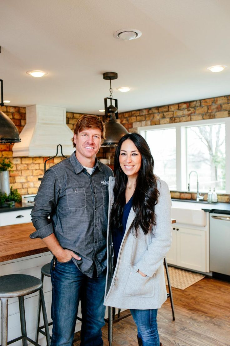 Hosts Chip and Joanna Gaines pose for a portrait in the King's new kitchen, as seen on Fixer Upper.