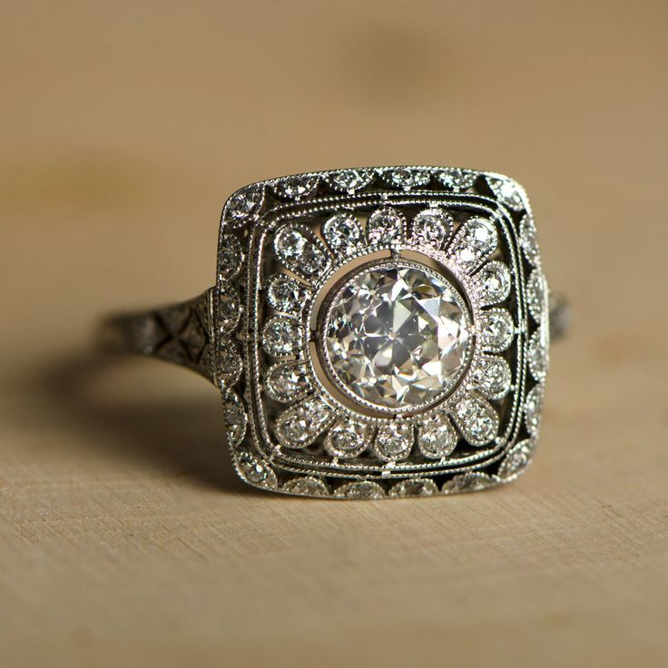 A beautiful old European cut diamond engagement ring, surrounded by elaborate and beautiful openwork filigree, and set into a stunning platinum ring.