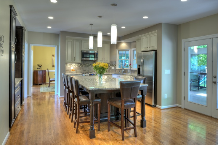 Kitchen remodeling project in Sterling, Virginia. The goal was to gain a large island with plenty of seating for the family, while still keeping a functional kitchen.