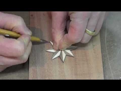 Watch and learn as the woodworker practices a router inlay technique. In this woodworking shop class a decorative star of maple and walnut is being inlaid into mahogany.    Watch more woodworking how to projects &  videos on YouTube...  Subscribe to the YouTube Channel:  http://www.youtube.com/user/appjourneyman  http://TheApprenticeandTheJourneyman....