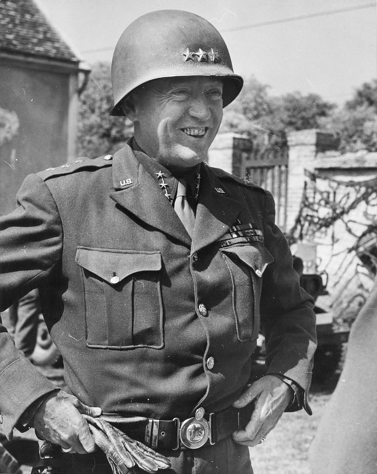 LtGen George Patton as he prepares to offer congratulations to his Third Armored Division for sweeping across northern France and crossing the River Seine northwest of Paris, 26 Aug 1944