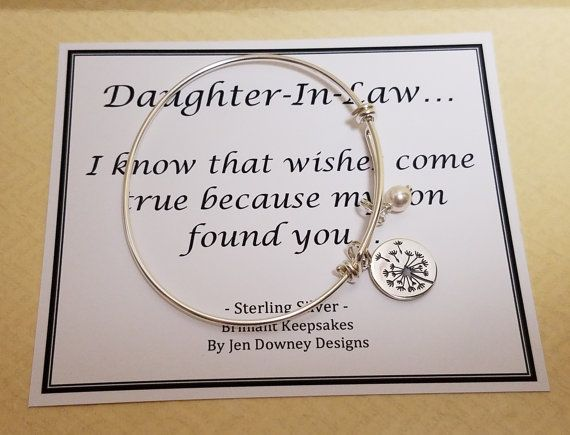 I know that wishes come true because my son found you...  This beautiful saying comes with a sterling silver dandelion charm bangle bracelet and makes a great keepsake for your new daughter in law.  Bangle itself is sterling silver as well as dandelion charm and components. The white Swarovski pearl and dandelion charm are attached securely via a sterlings silver split jump ring. Comes in a jewelry box tied with ribbon.  Sending this directly to someone? Be sure to include a note during the…