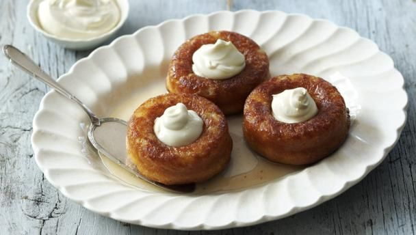 Rum babas | Impress your guests with this rum-soaked, retro classic.You will need four 11cm/4½in baba tins (savarin moulds). Alternatively you can use small dariole moulds.