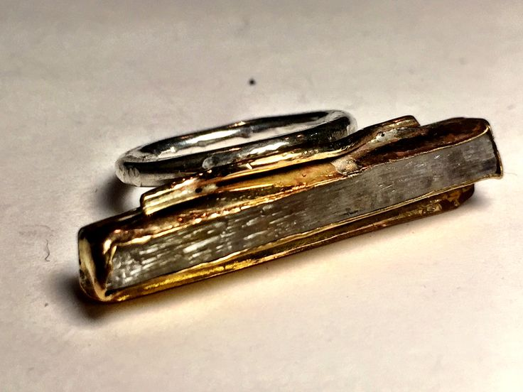 Kunzite in gold filled setting with silver band