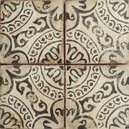 The charcoal and off white of the Paris underground's metro stations inspired these unique hand painted terracotta tiles.