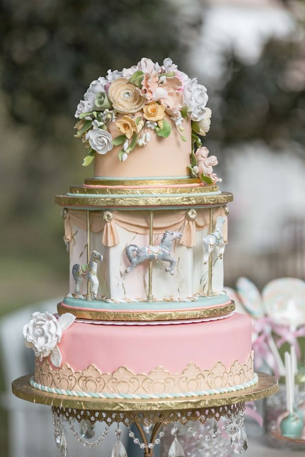 Carousel inspired wedding cake http://www.weddingchicks.com/2013/12/03/carousel-wedding-ideas/