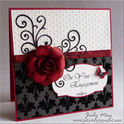 "Stamps: Well Scripted   Papers: Cherry Cobbler, Basic Black, Shimmer, Mocha Morning DSP, Neutrals Patterns DSP   Ink: Cherry Cobbler, Basic Black   Accessories Adhesive rhinestones, Cherry Cobbler Quilted ribbon   Tools: MFT Greetings, Flourish, Rolled Rose Dies, Beautiful Wings Embosslit, Swiss Dots embossing folder, Big Shot, Blossom Petal Punch, 1 1/4"" Circle punch, Dotted Scallop Ribbon punch, Shimmer Mist (using Champagne Shimmer paint), Dimensionals, Xyron, Tombow glue, sponge dauber"