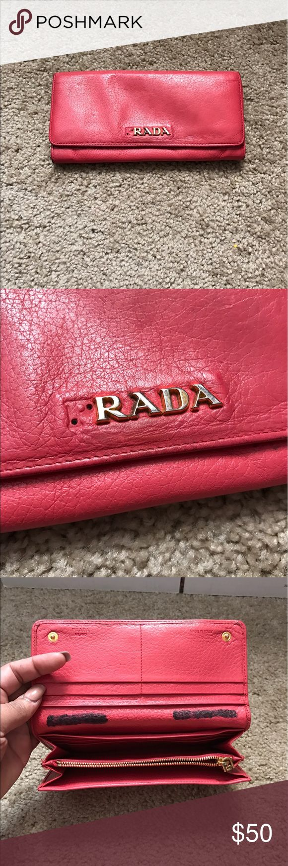 AUTHENTIC PRADA WALLET wallet is in ok condition . its missing the P from PRADA. also i had my name one and crossed it out..!!! other than that really cute wallet. Price marked to sell really sheap open to offers! no low ballers Prada Bags Wallets