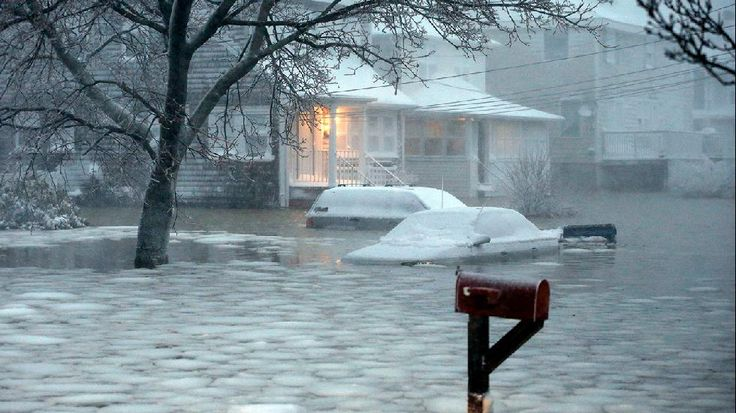 Juno: Heavy Snow Continues in New England - weather.com - Water floods a street on the coast in Scituate, Mass., Tuesday, Jan. 27, 2015. (AP Photo/Michael Dwyer)